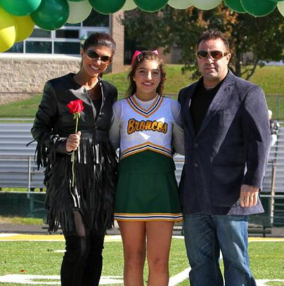 Teresa and Joe with Gia at her homecoming game one week ago